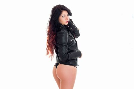 young woman with beautiful buttocks in leather jacket and lingerie isolated on white background