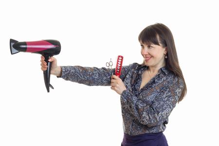 volwassen vrouw-kapper föhn houdt de hand op een witte achtergrond Stockfoto