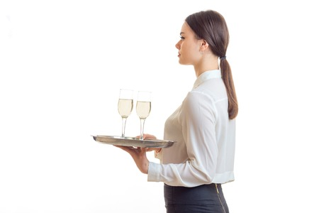 woman waitress with trey in hands wears a unifrom isolated on white background Stock Photo