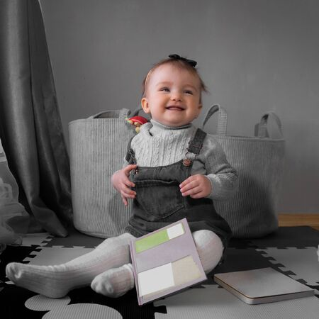 square picture of Cute little baby girl smiles at home Imagens