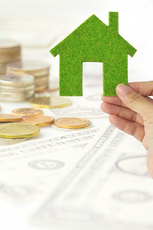 Hand holding eco house icon Stock Photo
