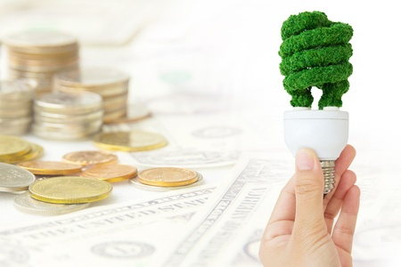 economize: hand holding eco bulb energy concept  Stock Photo