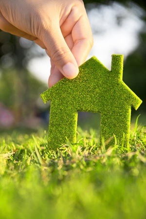 Eco house concept ,hand holding eco house icon in nature Stock Photo - 11605130