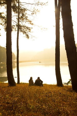 Sweet couple in love along the lake,In a romantic atmosphere. photo