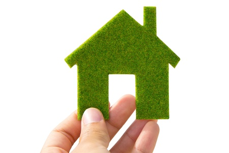 eco building: hand holding green Eco house icon concept