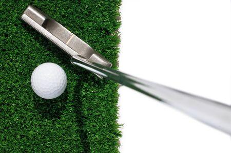 putter: Golf ball and putter on green grass  Stock Photo