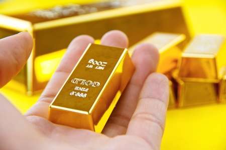 gold bar: Hand hold gold bars Stock Photo