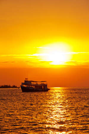 Fishing boat heading out to the sea in the early morning ,beautiful sunrise photo