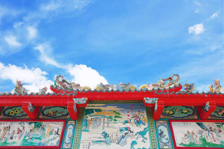 chinese temple roof on blue sky background, bangkok Thailand photo