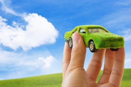 Eco car icon on blue sky background