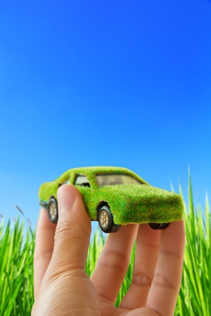 environmentally friendly: Hand Holding Eco car icon