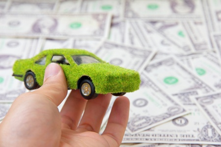 environmentally friendly: Hand Holding Eco car icon, save money concept