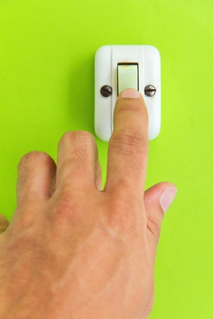 light switch: turn off the light,earth hour concept Stock Photo