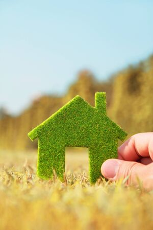 Hand holding eco house icon ,Concept Save green planet  photo