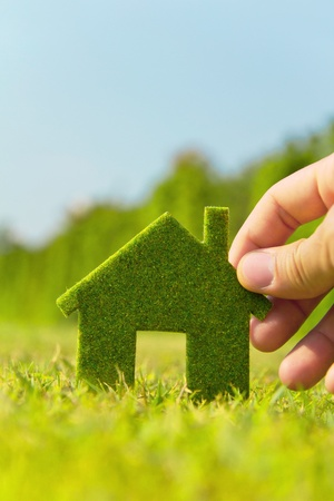 hand holding eco house icon Stock Photo