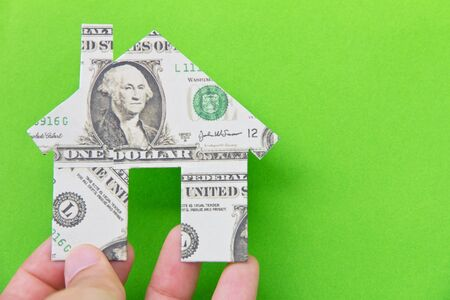 banknote house icon  isolate on green background photo