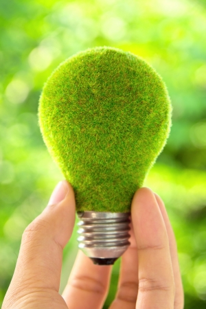 technological: hand holding eco light bulb energy concept Stock Photo