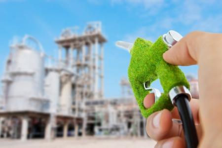 overuse: eco fuel nozzle,energy concept Stock Photo