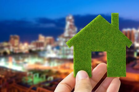 hand holding eco house icon, save energy concept