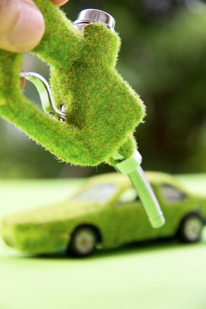 eco car: hand holding eco fuel nozzle Stock Photo