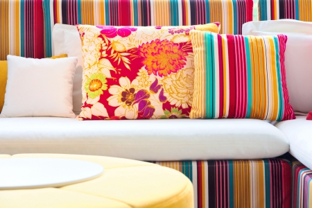 seating furniture: Colorful cushions in sofa