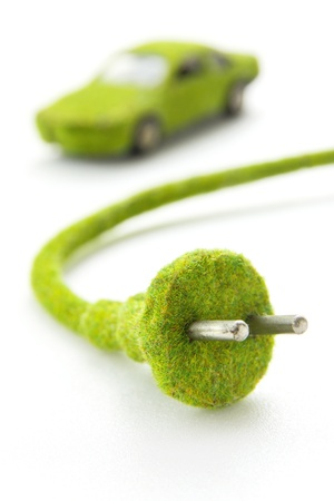 electric plug: green electric  plug with eco car icon, save energy concept Stock Photo