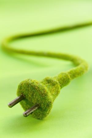 electric plug: abstract image of green electric plug , save energy concept Stock Photo