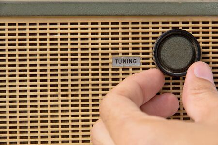 tuning: hand with tuner radio knob