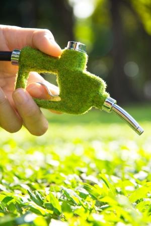 hand holding eco fuel nozzle Stock Photo - 16114062