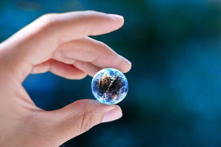 hand holding globe: Keep the world  Stock Photo