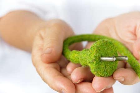 electric plug: green electric plug concept