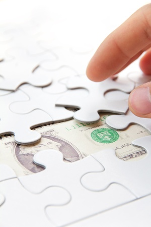 hand holding a puzzle piece, money concept Stock Photo - 17980145