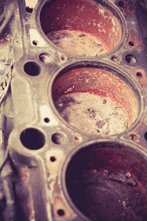 close up image of old automobile cylinder block ,car piston photo