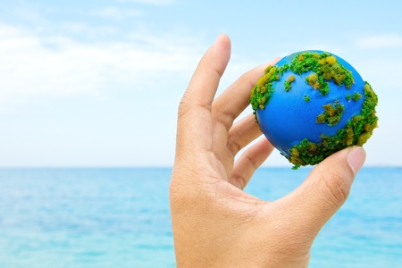 Hands and Earth  Concept Save green planet  photo