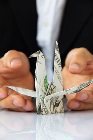 origami paper cranes, money concept photo