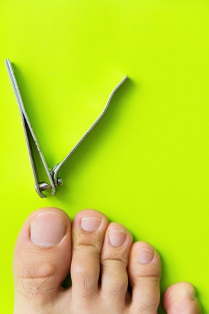 cutting your toenails concept Stock Photo - 21085986