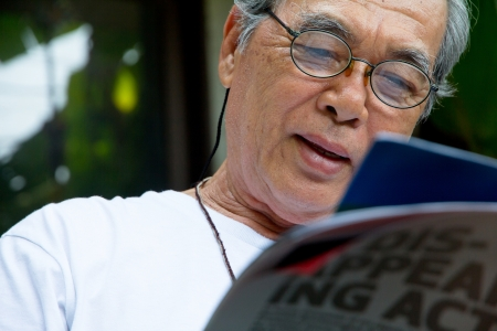 Senior man relaxing at home reading a book Stock Photo - 23242075