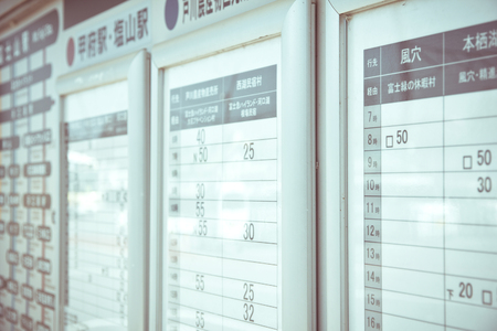 time table: the time table board of motor vehicles,bus station in tokyo japan