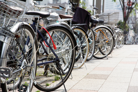 commuters: Lot of Bicycles parking at Tokyo, Japan  Stock Photo