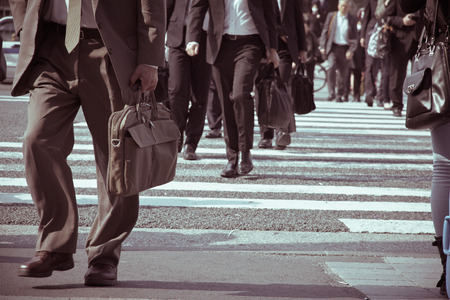 People commuting in rush hour at zebra crossing,Tokyo japan  Stock Photo