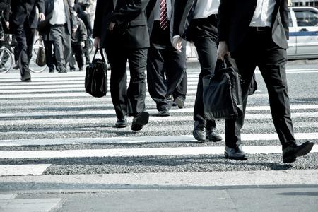 People commuting in rush hour at zebra crossing,Tokyo japan Imagens - 28854496