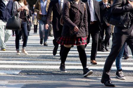 People commuting in rush hour at zebra crossing,Tokyo japan  Editorial