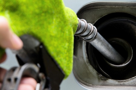 to fill up: eco fuel nozzle, Fill up the gas tank concept Stock Photo