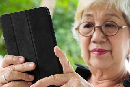 senior asian: Senior woman with tablet