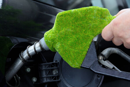 eco car: eco fuel nozzle,Fill up the gas tank concept Stock Photo
