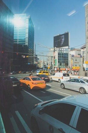traffic jams: On the way in Seoul Korea, Seoul, South Korea - November 3, 2014: Traffic jams at the intersection in the City of Sinchon, Seoul, Korea. Sinchon is a busy shopping district surrounde