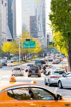 gangnam: Seoul, Republic of Korea - November 4, 2014: Traffic approaching on a busy road through the Gangnam district on November 4, 2014 in seoul, Gangnam is an affluent district in Seoul, South Korea. Editorial
