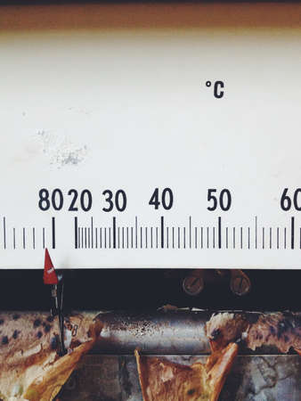 antique weight scale: Meter needle old barometer closeup
