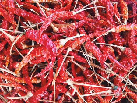 crushed red peppers: Dried Hot Pepper background Stock Photo
