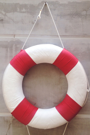 life jackets: life preserver on a wall